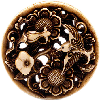 Image of netsuke decorated with a bird and lotus blossoms
